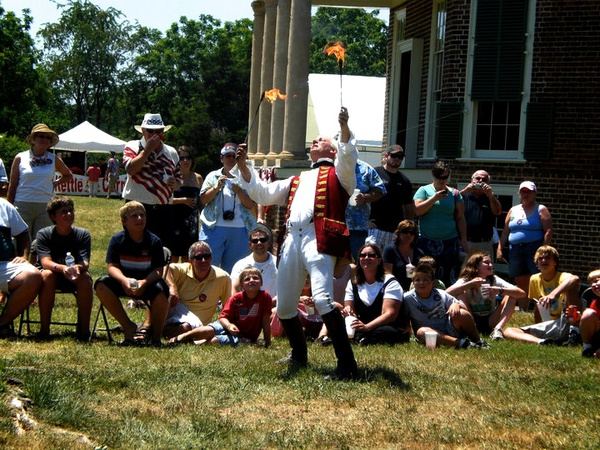 Crowds gather around a Fire Eater at the Poplar Forest Fourth of July Festivities, Photo by Joey Phoenix Photography